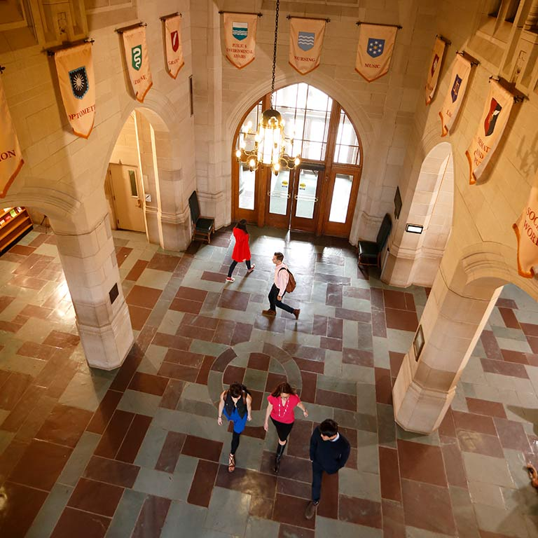 A birds-eye-view inside the Indiana Memorial Union, where students walk through the hallway below.